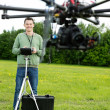 Happy Engineer Operating UAV in Park — Foto de Stock