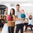 ������, ������: Excited Man And Woman With Bowling Balls in Club