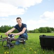 Technician With Octocopter Drone in Park — Stock Photo #31184637