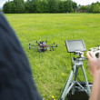 Technicians Operating UAV Helicopter in Park — Stock Photo #31184839
