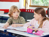 Schoolchildren Looking At Each Other In Classroom — Stock Photo