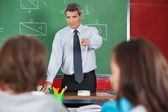 Angry Male Teacher Pointing At Students — Stock Photo