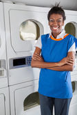 Confident Female Helper Standing In Front Of Dryers — Stock Photo