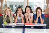 Schoolchildren Leaning At Desk Together — Stockfoto
