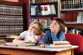 Thoughtful Schoolboys Sitting In Library — Stock Photo