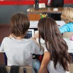 Schoolchildren Using Digital Tablet In Classroom — Stock Photo