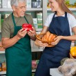 Salesman With Female Colleague Working In Supermarket — Stock Photo #31506329