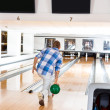 Man Going For The Last Pin in Bowling Alley — Stock Photo
