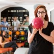 Young Woman Bowling in Club — Foto de Stock