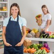 Saleswoman With Female Customer Shopping At Supermarket — Stock Photo