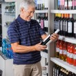 Man Buying Alcohol At Supermarket — Stock Photo