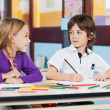 Boy Looking At Female Friend While Drawing In Classroom — Stock Photo