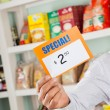 Stock Photo: Male Owner Holding Discount Sign In Supermarket