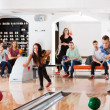Young Friends Playing in Bowling Alley — Stock Photo #31509259