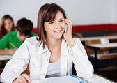 Teenage Girl Answering Mobilephone In Classroom — Stock Photo