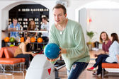 Man Playing in Bowling Alley At Club — Stock Photo