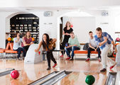 Young Friends Playing in Bowling Alley — Stock Photo