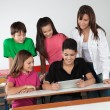 Students Using Digital Tablet At Desk — Stock Photo