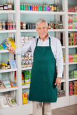 Male Store Owner Gesturing In Supermarket — Stock Photo