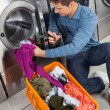 Man Putting Clothes In Washing Machine — Stock Photo #31523515