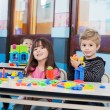 Foto de Stock  : Little Children Playing With Blocks In Preschool