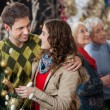 Young Couple In Christmas Store With Parents In Background — Stock Photo #31637371