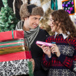 Happy Couple With Presents In Christmas Store — Stock Photo