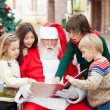 Children And Santa Claus Reading Book — Stock Photo