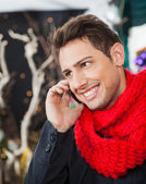 Man Using Mobilephone In Christmas Store — Stock Photo