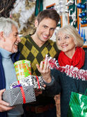 Man With Parents Shopping In Christmas Store — Stock Photo