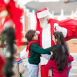 Children Embracing Santa Claus — Stock Photo