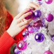 Owner Hanging Balls On Christmas Tree — Stock Photo