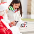 Surprised Girl Taking Gift From Santa Claus — Stock Photo #31649835