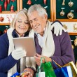 Happy Couple Using Digital Tablet At Christmas Store — Stock Photo