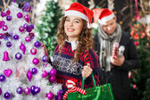 Beautiful Woman Carrying Shopping Bag At Christmas Store — Stock Photo