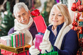 Woman Buying Presents With Man In Store — Stock Photo