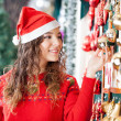 Beautiful Woman Buying Christmas Ornaments At Store — Stock Photo