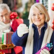 Woman Holding Credit Card At Christmas Store — Stock Photo