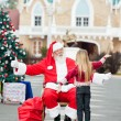 Santa Claus About To Embrace Girl — Stock Photo #31655687