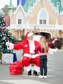 Santa Claus About To Embrace Girl — Stock Photo