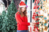 Beautiful Woman Buying Christmas Ornaments — Stock Photo