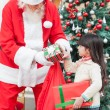 Santa Claus Giving Gifts To Girl — Stock Photo