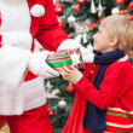 Santa Claus Giving Gift To Boy — Stock Photo #31725743