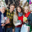 Happy Family Standing Together In Christmas Store — Stock Photo