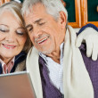 Couple Using Digital Tablet At Christmas Store — Stock Photo #31729351