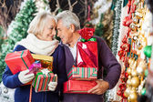 Romantic Couple In Christmas Store — Stock Photo