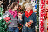 Happy Mother And Daughter In Christmas Store — Stock Photo