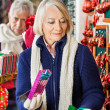 Senior Woman Shopping At Christmas Store — Stock Photo