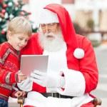Boy And Santa Claus Using Digital Tablet — Stock Photo