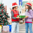 Boy Giving Present To Girl — Stock Photo